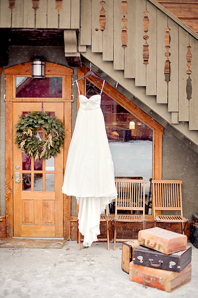 Wedding dress with vintage suitcases as props :: Canmore Wedding Photography by infusedstudios.ca