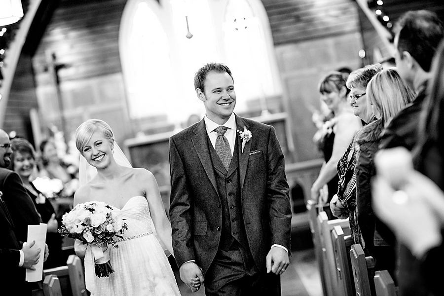 Coming down the aisle :: Canmore Wedding Photography by infusedstudios.ca