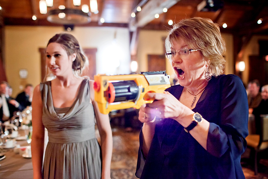 Nerf gun at the reception - fun! :: Canmore Wedding Photography by infusedstudios.ca