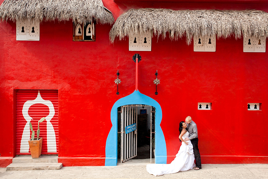 Red building background :: Destination Wedding Photography by infusedstudios.ca