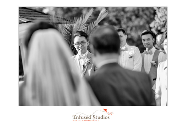 Groom's expression as bride comes down the aisle