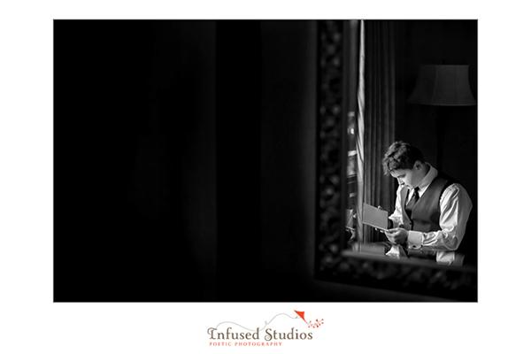 Groom reading wedding card