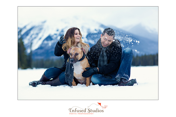 Outdoor winter engagement photo with dog