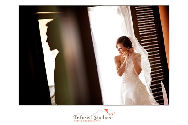 Focus on bride, groom in silhouette