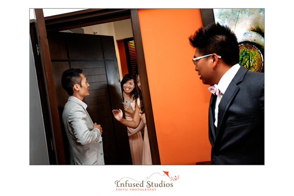 Groom being greeted by bridesmaid