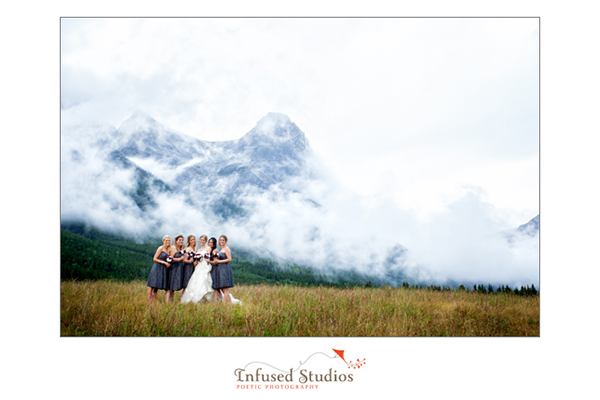 Bride and bridesmaids in front of Mountains