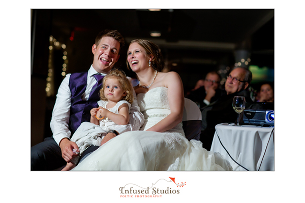Bride and groom with their little girl