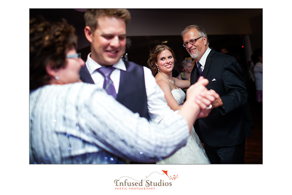 Bride and groom first dance with their parents