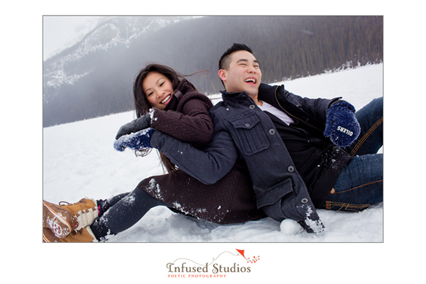 Playing on the ice at Lake Louise engagement photos