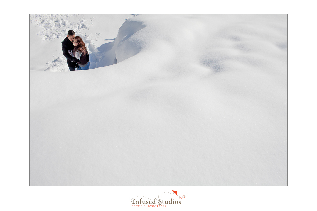 Snowy landscape engagement photography in Jasper