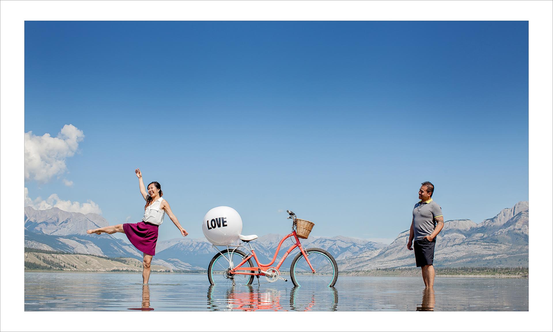 Award winning engagement photography album :: pgs 7-8 Bicycle on lake